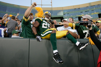 GREEN BAY, WI - AUGUST 22: Running back Ryan Grant #25 of the Green Bay Packers jumps in the stands to celebrate with fans after scoring a touchdown against the Buffalo Bills at Lambeau Field on August 22, 2009 in Green Bay. Wisconsin.  (Photo by Scott Bo