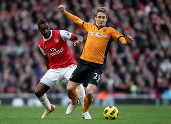 LONDON, ENGLAND - FEBRUARY 12:  Kevin Doyle of Wolves (R) in action with Johan Djourou of Arsenal during the Barclays Premier League match between Arsenal and Wolverhampton Wanderers on February 12, 2011 in London, England.  (Photo by Scott Heavey/Getty I