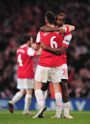 LONDON, ENGLAND - FEBRUARY 16:  Johan Djourou of Arsenal celebrates victory with Laurent Koscielny after the UEFA Champions League round of 16 first leg match between Arsenal and Barcelona at the Emirates Stadium on February 16, 2011 in London, England.