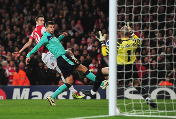 LONDON, ENGLAND - FEBRUARY 16: Robin van Persie of Arsenal has his shot saved by Victor Valdes of Barcelona during the UEFA Champions League round of 16 first leg match between Arsenal and Barcelona at the Emirates Stadium on February 16, 2011 in London,