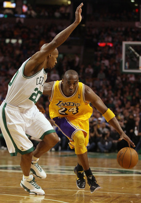 BOSTON, MA - FEBRUARY 10:  Kobe Bryant #24 of the Los Angeles Lakers drives around Ray Allen #20 of the Boston Celtics on February 10, 2011 at the TD Garden in Boston, Massachusetts.  The Lakers defeated the Celtics 92-86. NOTE TO USER: User expressly ack