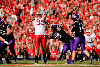 PASADENA, CA - JANUARY 01:  Defensive lineman J.J. Watt #99 of the Wisconsin Badgers defends a pass by quarterback Andy Dalton #14 of the TCU Horned Frogs during the 97th Rose Bowl game on January 1, 2011 in Pasadena, California.  (Photo by Kevork Djansez