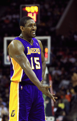 CHARLOTTE, NC - FEBRUARY 14:  Ron Artest #15 of the Los Angeles Lakers reacts to a call against the Charlotte Bobcats during their game at Time Warner Cable Arena on February 14, 2011 in Charlotte, North Carolina. NOTE TO USER: User expressly acknowledges