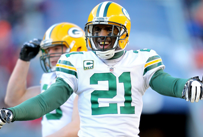 CHICAGO, IL - JANUARY 23:  Charles Woodson #21 of the Green Bay Packers reacts after teammate Sam Shields #37 intercepts a pass late in the second quarter of the NFC Championship Game at Soldier Field on January 23, 2011 in Chicago, Illinois.  (Photo by A