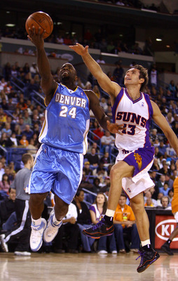 INDIAN WELLS, CA - OCTOBER 11:  Mateen Cleaves #24 of the Denver Nuggets drives to the basket past Steve Nash #13 of the Phoenix Suns during the second half of a preseason game at the Indian Wells Tennis Garden on October 11, 2008 in Indian Wells, Califor