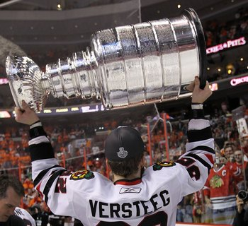 PHILADELPHIA - JUNE 09: Kris Versteeg #32 of the Chicago Blackhawks hoists the Stanley Cup after the Blackhawks defeated the Philadelphia Flyers 4-3 in overtime to win the Stanley Cup in Game Six of the 2010 NHL Stanley Cup Final at the Wachovia Center on