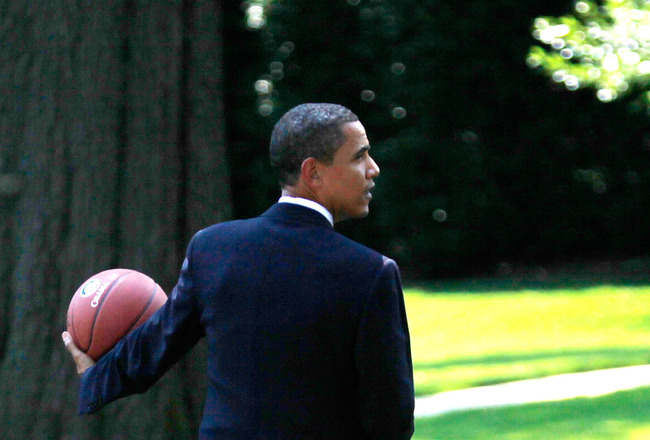 WASHINGTON - JULY 27:  U.S. President Barack Obama holds a basketball as he walks toward the Oval Office after he hosted Detroit Shock at the South Portico of the White House July 27, 2009 in Washington, DC. The President hosted the Detroit Shock in honor