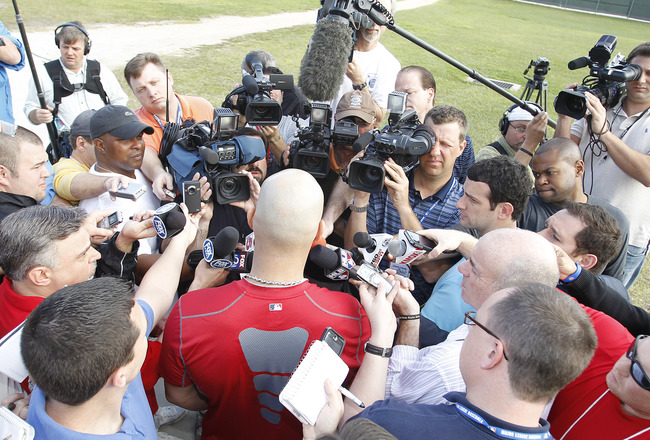 JUPITER, FL - FEBRUARY 17: Albert Pujols #5 of the St. Louis Cardinals answers questions from the media at Roger Dean Stadium on February 17, 2011 in Jupiter, Florida. (Photo by Joel Auerbach/Getty Images)