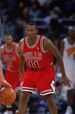 21 Nov 2000:  A.J. Guyton #11 of the Chicago Bulls drops back into position during the game against the Golden State Warriors at the Network Associates Stadium in Oakland, California. The Warriors defeated the Bulls 89-74.   NOTE TO USER: It is expressly