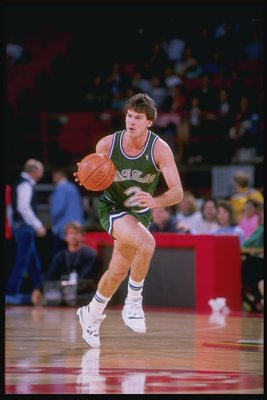 1989:  Steve Alford of the Dallas Mavericks drives the ball down the court during a game against the Denver Nuggets at McNichols Arena in Denver, Colorado. Mandatory Credit: Tim de Frisco  /Allsport