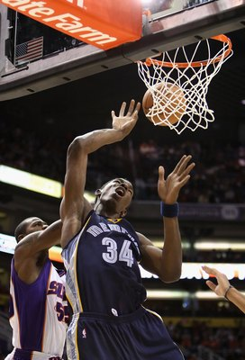 PHOENIX - NOVEMBER 25:  Hasheem Thabeet #34 of the Memphis Grizzlies is fouled as he puts up a shot during the NBA game against the Phoenix Suns at US Airways Center on November 25, 2009 in Phoenix, Arizona.  The Suns defeated the Grizzlies 126-111.  NOTE