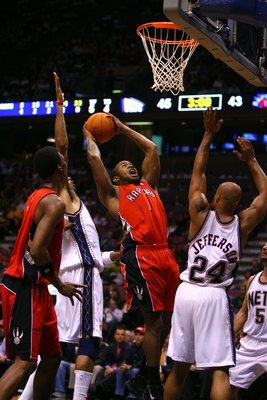 EAST RUTHERFORD, NJ - NOVEMBER 1:  P.J. Tucker #1 of the Toronto Raptors shoots over Richard Jefferson #24 of the New Jersey Nets during the game at the Continental Airlines Arena on November 1, 2006 in East Rutherford, New Jersey. The Nets won 102-92. NO