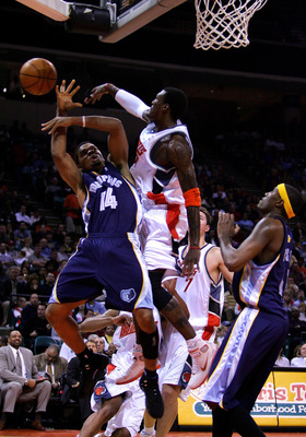 CHARLOTTE, NC - JANUARY 14:  Andre Emmett #14 of the Memphis Grizzlies is fouled by Gerald Wallace #3 of the Charlotte Bobcats on January 14, 2005 at the Charlotte Coliseum in Charlotte, North Carolina.  NOTE TO USER: User expressly acknowledges and agree