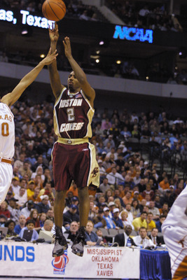 DALLAS - MARCH 15:  Guard Troy Bell #2 of the Boston College Eagles shoots the ball over center James Thomas #0 of the Texas Longhorns during the first round game of the 2002 NCAA Division I Men's Basketball Championship at American Airlines Arena in Dall