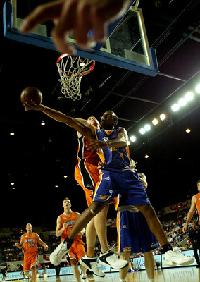 SYDNEY, AUSTRALIA - FEBRUARY 18: Chris Carrawell #8 of the Kings in action during the round 21 NBL match between the Sydney Kings and the Victoria Giants at the Sydney Entertainment Centre February 18, 2004 in Sydney, Australia.  (Photo by Nick Laham/Gett