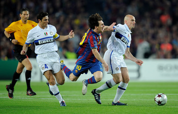 BARCELONA, SPAIN - APRIL 28: Lionel Messi of Barcelona is tackled by Javier Zanetti and Esteban Cambiasso of Inter Milan during the UEFA Champions League Semi Final Second Leg match between Barcelona and Inter Milan at Camp Nou on April 28, 2010 in Barcel