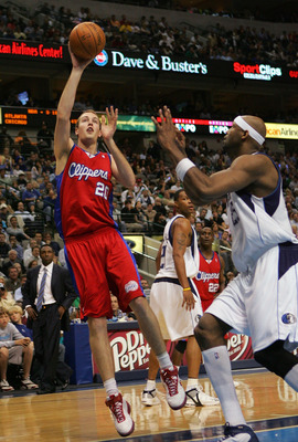 DALLAS - MARCH 25:  Nick Fazekas #20 of the Los Angeles Clippers takes a shot against Erick Dampier #25 of the Dallas Mavericks on March 25, 2008 at American Airlines Center in Dallas, Texas.  NOTE TO USER: User expressly acknowledges and agrees that, by