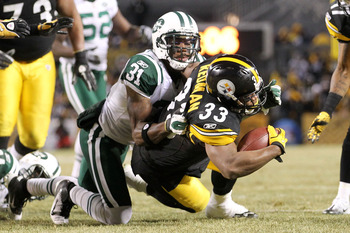 PITTSBURGH, PA - JANUARY 23:  Isaac Redman #33 of the Pittsburgh Steelers is tackled by Antonio Cromartie #31 of the New York Jets during the 2011 AFC Championship game at Heinz Field on January 23, 2011 in Pittsburgh, Pennsylvania.  (Photo by Ronald Mart