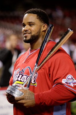 ST LOUIS, MO - JULY 13:  National League All-Star Prince Fielder of the Milwaukee Brewers celebrates with the trophy after winning the State Farm Home Run Derby at Busch Stadium on July 13, 2009 in St. Louis, Missouri.  (Photo by Jamie Squire/Getty Images
