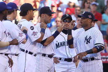 ANAHEIM, CA - JULY 13:  American League All-Star Robinson Cano #24 of the New York Yankees greets his teammates on the American League All-Star team prior to the 81st MLB All-Star Game at Angel Stadium of Anaheim on July 13, 2010 in Anaheim, California.