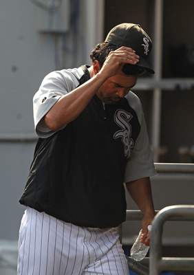 CHICAGO - AUGUST 29: Manager Ozzie Guillen #13 of the Chicago White Sox heads to the locker room after being thrown out of a game against the New York Yankees in the 9th inning at U.S. Cellular Field on August 29, 2010 in Chicago, Illinois. The Yankees de