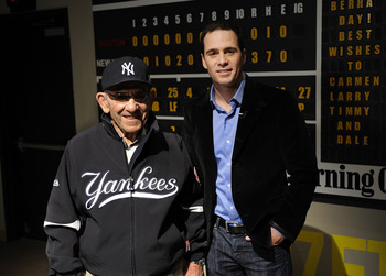 LITTLE FALLS, NJ - NOVEMBER 23:  Baseball Hall of Famer Yogi Berra and four-time Nascar champion Jimmie Johnson pose for a picture in the theater at the Yogi Berra Museum and and Learning Center on November 23, 2009 in Little Falls, New Jersey.  (Photo by