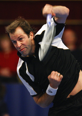 LONDON - DECEMBER 07:  Greg Rusedski of Great Britain serves to Cedric Pioline of France during the final of the BlackRock Masters Tennis at the Royal Albert Hall on December 7, 2008 in London, England.  (Photo by Julian Finney/Getty Images)