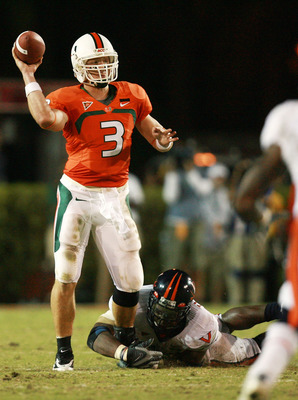 CORAL GABLES, FL - NOVEMBER 10:  Quarterback Kyle Wright #3 of the Miami Hurricanes gets the pass off despite the defensive pressure the Virginia Cavaliers at the Orange Bowl November 10, 2007 in Coral Gables, Florida.  (Photo by Doug Benc/Getty Images)