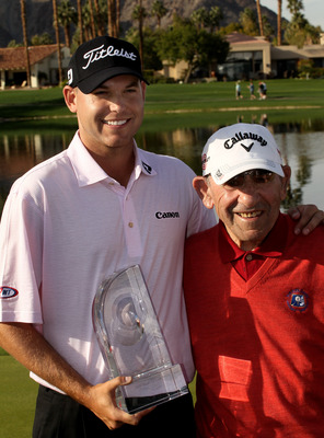 LA QUINTA, CA - JANUARY 25: Bill Haas poses for pictures with tournament ambassador and baseball Hall of Famer Yogi Berra at the Palmer Private course at PGA West after winning the Bob Hope Classic on January 25, 2010 in La Quinta, California. (Photo by S