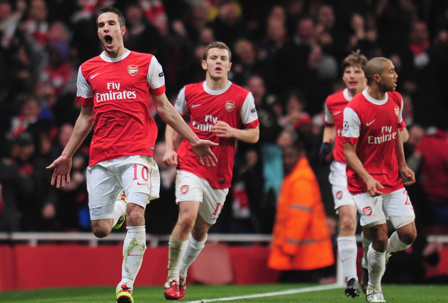LONDON, ENGLAND - FEBRUARY 16:  Robin van Persie of Arsenal celebrates Arsenal's first goal during the UEFA Champions League round of 16 first leg match between Arsenal and Barcelona at the Emirates Stadium on February 16, 2011 in London, England.  (Photo