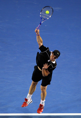 MELBOURNE, AUSTRALIA - JANUARY 23:  Andy Roddick of the United States of America serves in his fourth round match against Stanislas Wawrinka of Switzerland during day seven of the 2011 Australian Open at Melbourne Park on January 23, 2011 in Melbourne, Au