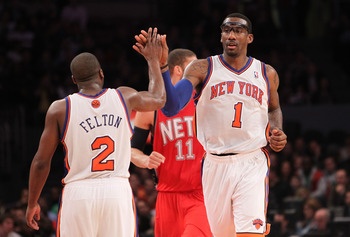 NEW YORK, NY - NOVEMBER 30:  Amar'e Stoudemire #1 of the New York Knicks high fives teammate Raymond Felton #2l against the New Jersey Nets on November 30, 2010 at Madison Square Garden in New York City. NOTE TO USER: User expressly acknowledges and agree