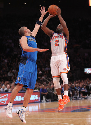 NEW YORK, NY - FEBRUARY 02: Raymond Felton #2 of the New York Knicks shoots the ball over Jason Kidd #2 of the Dallas Mavericks at Madison Square Garden on February 2, 2011 in New York City. NOTE TO USER: User expressly acknowledges and agrees that, by do