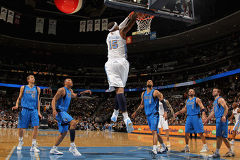 DENVER, CO - FEBRUARY 10:  Carmelo Anthony #15 of the Denver Nuggets dunks the ball against the Dallas Mavericks during NBA action at the Pepsi Center on February 10, 2011 in Denver, Colorado. The Nuggets defeated the Mavericks 121-120. NOTE TO USER: User