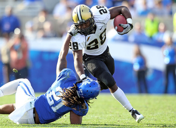 LEXINGTON, KY - NOVEMBER 13:  Kennard Reeves # 28 of the Vanderbilt Commodores is tackled by Winston Guy #21 of the Kentucky Wildcats during the game at Commonwealth Stadium on November 13, 2010 in Lexington, Kentucky.  (Photo by Andy Lyons/Getty Images)