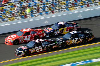 DAYTONA BEACH, FL - FEBRUARY 17:  Kevin Harvick, driver of the #29 Budweiser Chevrolet, Juan Pablo Montoya, driver of the #42 Target Chevrolet, Kasey Kahne, driver of the #4 Red Bull Toyota, and Matt Kenseth, driver of the #17 Crown Royal Ford, race durin