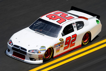 DAYTONA BEACH, FL - FEBRUARY 12:  Brian Keselowski, driver of the #92 K-Automotive Motorsports Dodge, practices for the NASCAR Sprint Cup Series Daytona 500 at Daytona International Speedway on February 12, 2011 in Daytona Beach, Florida.  (Photo by John