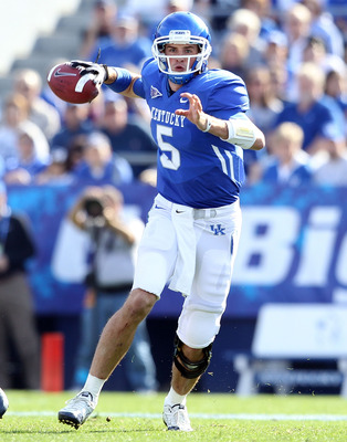 LEXINGTON, KY - NOVEMBER 13:  Mike Hartline #5 of the Kentucky Wildcats throws the ball during the game against the Vanderbilt Commodores at Commonwealth Stadium on November 13, 2010 in Lexington, Kentucky. Kentucky won 38-20.  (Photo by Andy Lyons/Getty