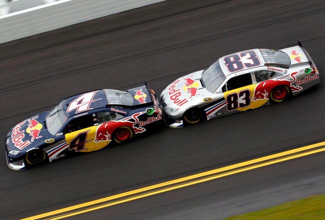 DAYTONA BEACH, FL - FEBRUARY 16:  Kasey Kahne, driver of the #4 Red Bull Toyota, leads Brian Vickers, driver of the #83 Red Bull Toyota, during practice for the NASCAR Sprint Cup Series Daytona 500 at Daytona International Speedway on February 16, 2011 in