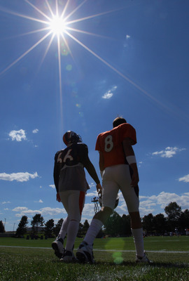 ENGLEWOOD, CO - AUGUST 18:  Quaterback Kyle Orton #8 and long snapper Lonie Paxton #66 of the Denver Broncos head to the field under the midday sun for training camp practice at Dove Valley on August 18, 2010 in Englewood, Colorado. The forecasted record