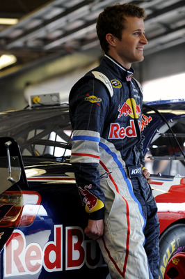 DAYTONA BEACH, FL - FEBRUARY 16:  Kasey Kahne, driver of the #4 Red Bull Toyota, looks on in the garage area during practice for the NASCAR Sprint Cup Series Daytona 500 at Daytona International Speedway on February 16, 2011 in Daytona Beach, Florida.  (P