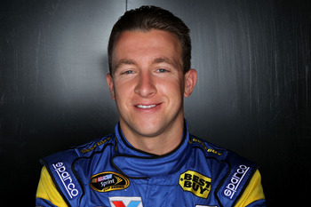 DAYTONA BEACH, FL - FEBRUARY 10:  AJ Allmendinger, driver of the #43 Best Buy Ford, poses during the 2011 NASCAR Media Day at Daytona International Speedway on February 10, 2011 in Daytona Beach, Florida.  (Photo by Nick Laham/Getty Images for NASCAR)