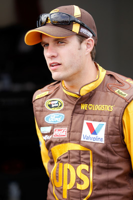 DAYTONA BEACH, FL - FEBRUARY 16:  David Ragan, driver of the #6 UPS Ford, looks on in the garage area during practice for the NASCAR Sprint Cup Series Daytona 500 at Daytona International Speedway on February 16, 2011 in Daytona Beach, Florida.  (Photo by