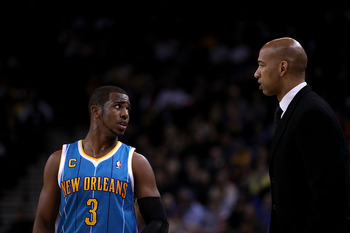 OAKLAND, CA - FEBRUARY 15:  Chris Paul #3 of the New Orleans Hornets speaks to head coach Monty Williams at Oracle Arena on February 15, 2011 in Oakland, California. NOTE TO USER: User expressly acknowledges and agrees that, by downloading and or using th