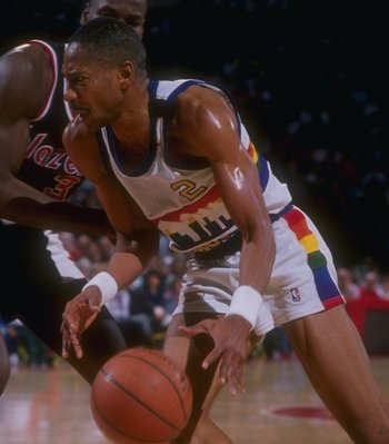 1989-1990:  Guard Alex English of the Denver Nuggets moves the ball during a game versus the Portland Trailblazers at the McNichols Sports Arena in Denver, Colorado. Mandatory Credit: Tim DeFrisco  /Allsport Mandatory Credit: Tim DeFrisco  /Allsport