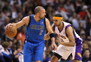 PHOENIX, AZ - FEBRUARY 17:  Jason Kidd #2 of the Dallas Mavericks handles the ball under pressure from Jared Dudley #3 of the Phoenix Suns during the NBA game at US Airways Center on February 17, 2011 in Phoenix, Arizona.  NOTE TO USER: User expressly ack