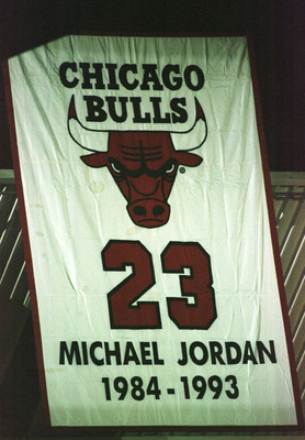 13 Jan 1999: A banner with Jordan''s jersey number 23 is raised after Michael Jordan of the Chicago Bulls announces his retirement from the NBA during a press conference at the United Center in Chicago, Illinois. The banner had first been raised after Jor