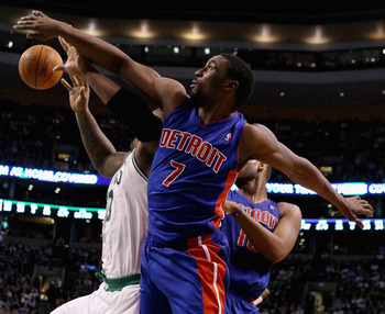 BOSTON, MA - JANUARY 19:  Ben Gordon #7 of the Detroit Pistons and Glen Davis #11 of the Boston Celtics fight for the rebound in the final seconds of the game on January 19, 2011 at the TD Garden in Boston, Massachusetts. The Celtics defeated the Pistons