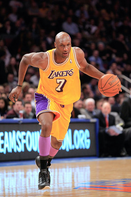 NEW YORK, NY - FEBRUARY 11: Lamar Odum #7 of the Los Angeles Lakers dribbles against the New York Knicks at Madison Square Garden on February 11, 2011 in New York City. NOTE TO USER: User expressly acknowledges and agrees that, by downloading and/or using