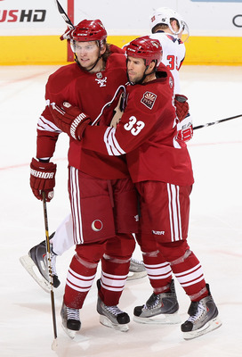 GLENDALE, AZ - FEBRUARY 14:  Martin Hanzal #11 and Adrian Aucoin #33 of the Phoenix Coyotes celebrate after Hanzal scored a second period goal against the Washington Capitals during the NHL game at Jobing.com Arena on February 14, 2011 in Glendale, Arizon